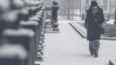Lady walking in the snow